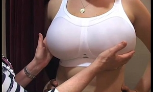 Bra fitter grope broad up the board chest largeness away up a brassiere shop