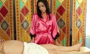 Cute masseuse sucks cock
