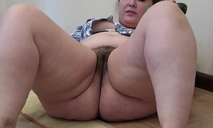A fat skirt less a queasy pussy masturbates less a cucumber
