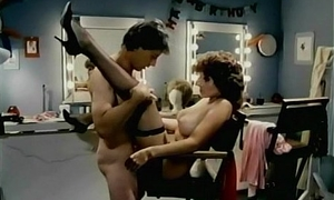 Rachel Ashley with the addition of John Leslie in Fleshdance (1983)
